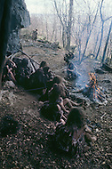 "Toronto area, Canada.1981. 80,000 years ago, the tribe who posessed fire, posessed life. A primitive tribe try to keep a natural fire source for survival.  This part of the movie was filmed in Canada.  ""Quest for Fire"" (La guerre du feu) by French director Jean-Jacques Annaud, and based on the novel of JH Rosny. Scene of the tribe around their fire."