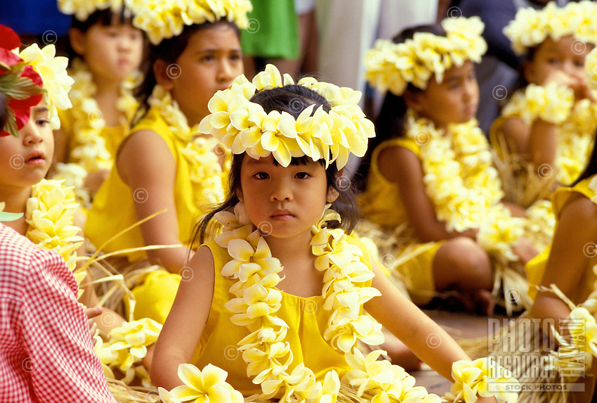 EDITORIAL ONLY. Children wearing plumeria leis prepare to dance hula