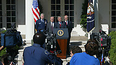 Washington, D.C. - September 3, 2005 -- The media records United States President George W. Bush as he delivers his weekly radio address live from the Rose Garden on September 3,2005. Left to right: Chairman of the Joint Chiefs of Staff General Richard Myers, United States Air Force, United States Secretary of Defense Donald Rumsfeld, the President, and United States Secretary of the Department of Homeland Security Michael Chertoff. <br /> Credit: Dennis Brack - Pool via CNP