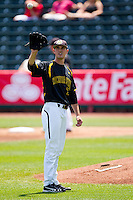 Kris Gardner (13) of the Wichita State Shockers catches a ball tossed to him during a game against the Missouri State Bears in the 2012 Missouri Valley Conference Championship Tournament at Hammons Field on May 23, 2012 in Springfield, Missouri. (David Welker/Four Seam Images)