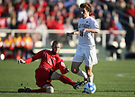 16 December 2007: Ohio State's Doug Verhoff (15) slide tackles the ball away from Wake Forest's Cody Arnoux (r). The Wake Forest University Demon Deacons defeated the Ohio State Buckeyes 2-1 at SAS Stadium in Cary, North Carolina in the NCAA Division I Mens College Cup championship game.