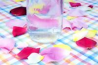 Water bottle with rose petals on dinner table. Summer Lake Inn. Oregon