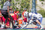 Los Angeles, CA 04/01/16 - Justin Collier (USC #20) and Ren-Taylor Chang (Loyola Marymount #20) in action during the University of Southern California and Loyola Marymount University SLC conference game  USC defeated LMU.