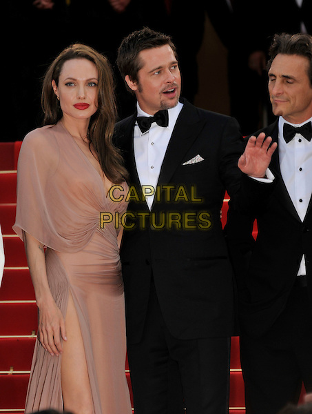 "ANGELINA JOLIE & BRAD PITT.The ""Inglourious Basterds"" Premiere at the Grand Theatre Lumiere during the 62nd Annual Cannes Film Festival, Cannes, France..May 20th, 2009.length half 3/4 dress sheer wrap beige pink cream black tuxedo couple goatee facial hair slit split thigh red lipstick hand mouth open.CAP/PL.©Phil Loftus/Capital Pictures."