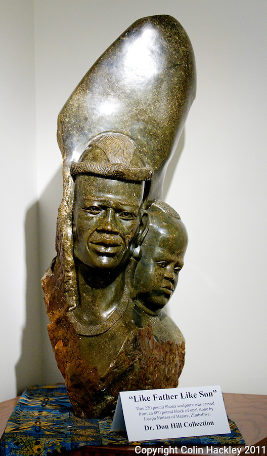 """LIKE FATHER LIKE SON:"" The 220 pound Shona sculpture carved from Opal anchors a corner of Africa Room collection at The Black Archives in Tallahassee..COLIN HACKLEY PHOTO"