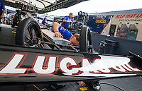 May 17, 2015; Commerce, GA, USA; NHRA top fuel driver Richie Crampton inspects a weld to the chassis of his dragster during the Southern Nationals at Atlanta Dragway. Mandatory Credit: Mark J. Rebilas-USA TODAY Sports