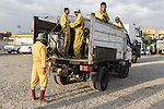 10/10/2014 -- Kirkuk, Iraq -- Bangladeshi workers are getting ready to go to work cleaning the streets.