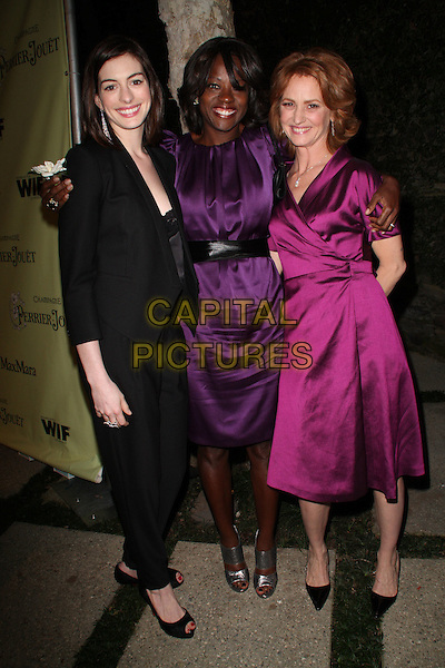 ANNE HATHAWAY, VIOLA DAVIS & MELISSA LEO .Women in Film's 2nd Annual Pre-Oscar Cocktail Party held at Private Residence, Bel Air, CA, USA,  20 February 2009..full length black suit trousers jacket blazer tuxedo lace cami peep toe shoes purple silk satin dress waist belt grey gray bootie open toe patent pink magenta wrap .CAP/ADM/KB.©Kevan Brooks/Admedia/Capital PIctures