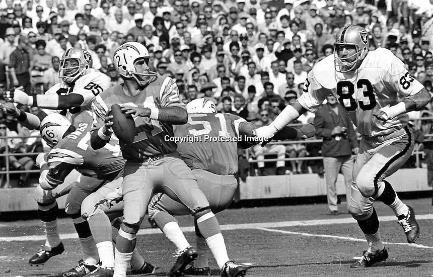 Raiders rush San Diego quarternack John Hadl #21, #85 Carlton Oats, and #83 Ben Davidson. (1969 photo/Ron Riesterer)