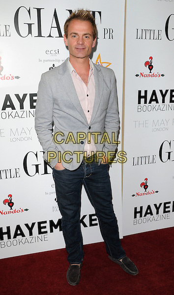 JULIAN BENNETT .At the Joshua Foundation Gala Fundraiser, May Fair Hotel, London, England, UK, April 16th 2011..full length grey gray jacket jeans hands in pockets  loafers moccasins shirt .CAP/CAN.©Can Nguyen/Capital Pictures.