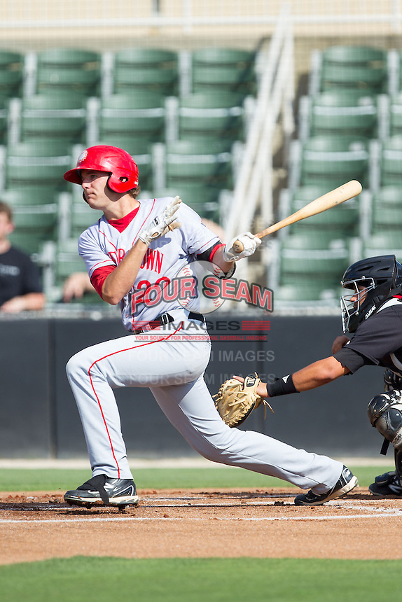 John Wooten (22) of the Hagerstown Suns follows through on his swing against the Kannapolis Intimidators at CMC-Northeast Stadium on May 31, 2014 in Kannapolis, North Carolina.  The Intimidators defeated the Suns 3-2 in game one of a double-header.  (Brian Westerholt/Four Seam Images)