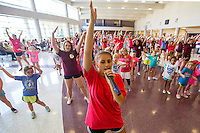 NWA Democrat-Gazette/JASON IVESTER <br /> Rogers High senior dance team member Katie Forbis (cq) leads a dance routine on Thursday, Sept. 10, 2015, with participants in the Mini Mounties Spirit Clinic at Rogers High School. About 200 girls from kindergarten through fifth grade learned cheer and dance routines from the Mounties Spirit Squads.