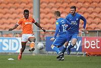 Blackpool's Marc Bola under pressure from Peterborough United's Louis Reed<br /> <br /> Photographer Kevin Barnes/CameraSport<br /> <br /> The EFL Sky Bet League One - Blackpool v Peterborough United - Saturday 13th April 2019 - Bloomfield Road - Blackpool<br /> <br /> World Copyright &copy; 2019 CameraSport. All rights reserved. 43 Linden Ave. Countesthorpe. Leicester. England. LE8 5PG - Tel: +44 (0) 116 277 4147 - admin@camerasport.com - www.camerasport.com