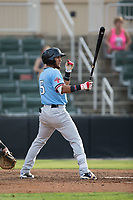 Miguel Aparicio (5) of the Hickory Crawdads at bat against the Kannapolis Intimidators in game one of a double-header at Kannapolis Intimidators Stadium on May 19, 2017 in Kannapolis, North Carolina.  The Crawdads defeated the Intimidators 5-4.  (Brian Westerholt/Four Seam Images)