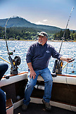 ALASKA, Ketchikan, Captain Tony tends to his lines while fishing the Behm Canal near Clarence Straight, Knudsen Cove along the Tongass Narrows
