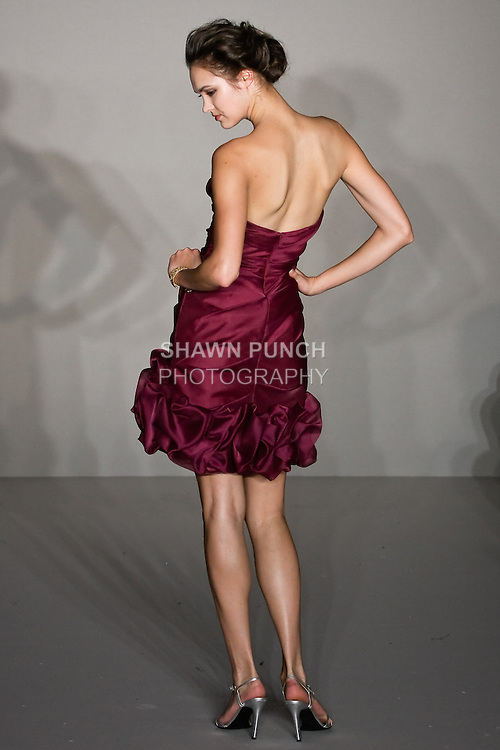 Model walks runway in a Wine organza strapless draped dress, scrunched hem bridesmaid outfit by Fracesca Pitera for the Jim Hjelm Spring 2012 collection, at the JLM Couture fashion show, during Bridal Week New York Spring 2012.
