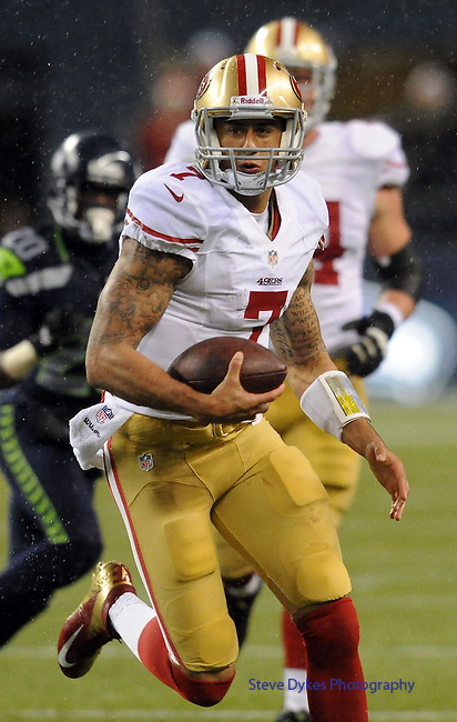 SEATTLE, WA. - DECEMBER 23: Quarterback Colin Kaepernick #7 of the San Francisco 49ers runs with the ball during the fourth quarter of the game against the Seattle Seahawks at CenturyLink Field on December 23, 2012 in Seattle,Wa. (Photo by Steve Dykes/Getty Images) *** Local Caption *** Colin Kaepernick
