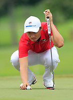 Li Haotong (Asia) on the 1st green during the Singles Matches of the Eurasia Cup at Glenmarie Golf and Country Club on the Sunday 14th January 2018.<br /> Picture:  Thos Caffrey / www.golffile.ie