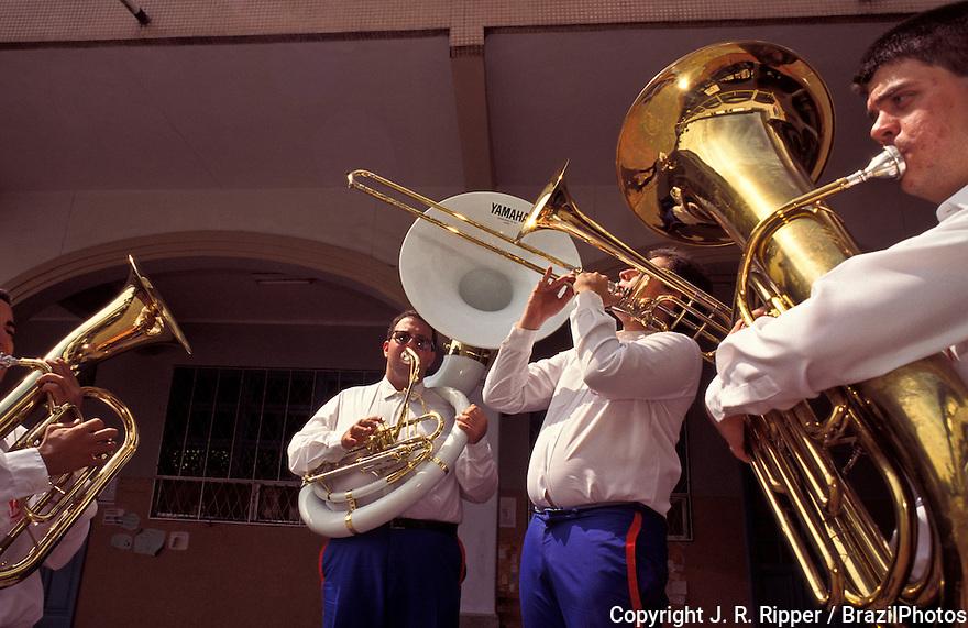 Musicians play wind instruments, band. Rio de Janeiro, Brazil.