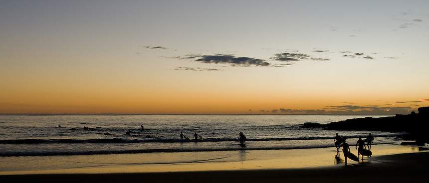 sunrise at manly beach, surfers surf