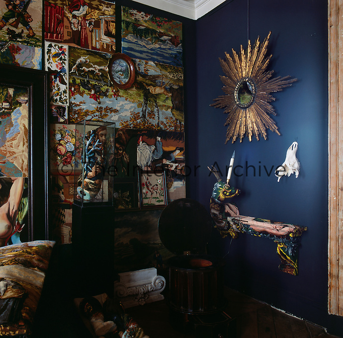 A corner of one of the rooms in the apartment of artist Frederique Morrel. The apartment where she lives is also her studio and a reflection of her work. She works with tapestry to create animal heads, human figures and other objects