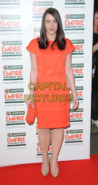 Michelle Ryan .Jameson Empire Film Awards at the Grosvenor House Hotel, Park Lane, London, England..March 25th 2012.full length orange dress clutch bag beige shoes .CAP/BF.©Bob Fidgeon/Capital Pictures.