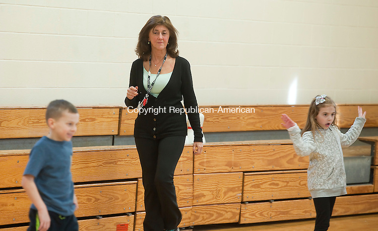 MIDDLEBURY, CT--- -010716JS09--Melody McVerry, a physical education teacher at Long Meadow Elementary School in Middlebury, works with her kindergartner class as they stretch during class on Thursday. McVerry was named the Connecticut Elementary School Physical Education Teacher of the year by the Connecticut Association for Health, Physical Education, Recreation and Dance. <br /> Jim Shannon Republican-American
