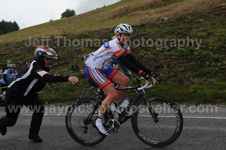 Competitors climb the challenging iconic and notorious 6km 10% stretch of road namely The Tumble during the Wales Velothon 2016 140km route cycling race. This Lady gets a push start before continuing.  <br /> <br /> <br /> Jeff Thomas Photography -  www.jaypics.photoshelter.com - <br /> e-mail swansea1001@hotmail.co.uk -<br /> Mob: 07837 386244 -