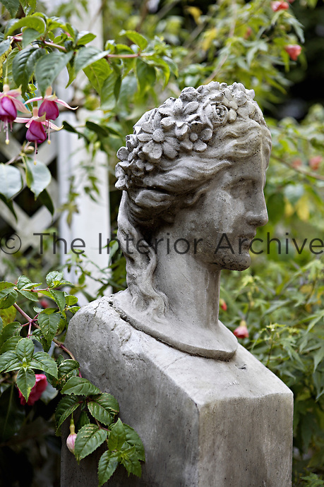 A classical sculpture gazes serenely over the garden