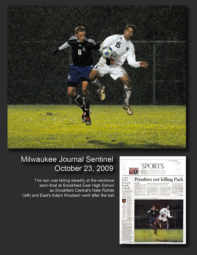 The rain was falling at the soccer sectional semifinal at Brookfield East High School as Brookfield Central's Nate Rohde (left) and East's Adam Knudsen go after the ball on Thursday, Oct. 22, 2009. Ernie Mastroianni photo.
