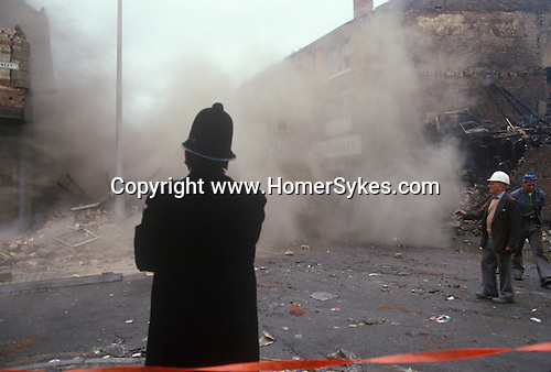 Toxteth Liverpool Lancashire 1981. Building having been destroyed in the  riots are demolished the following day.