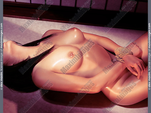 Beautiful naked woman with shiny nude body lying down with her hands tied with a rope