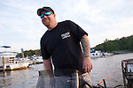 Mike Brookover, owner and operator of Precision Wildlife Nuisance Control, heads out for a night of bow fishing on Aquia Creek, near Stafford, Virginia on June 20, 2013. CREDIT: Lance Rosenfield