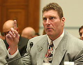 "Washington, D.C. - April 27, 2005 -- Steve Courson, former player for the National Football League's (NFL) Pittsburgh Steelers and Tampa Bay Buccaneers testifies before the United States House of Representatives Committee on Government Reform in Washington, D.C. on April 27, 2005.  He discussed the league's drug policies during the hearing ""Steroid Use in Sports Part II: Examining the National Football League's Policy on Anabolic Steroids and Related Substances"".  Courson has had health problems related to his use of steroids when he was a player in the 1970s and early 1980s which included cardiac disease.  He testified that his number one question for himself was ""could I have made it without steroid use ?"".Credit: Ron Sachs / CNP..(RESTRICTION: NO New York or New Jersey Newspapers or newspapers within a 75 mile radius of New York City)"