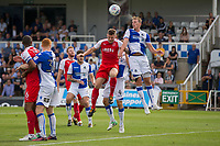 Joe Partington of Bristol Rovers clears under pressure from Ashley Eastham of Fleetwood Town during the Sky Bet League 1 match between Bristol Rovers and Fleetwood Town at the Memorial Stadium, Bristol, England on 26 August 2017. Photo by Mark  Hawkins.