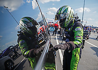 Sep 16, 2016; Concord, NC, USA; NHRA funny car driver Alexis DeJoria reflects in the window of her tow vehicle as she prepares to get into her car during qualifying for the Carolina Nationals at zMax Dragway. Mandatory Credit: Mark J. Rebilas-USA TODAY Sports