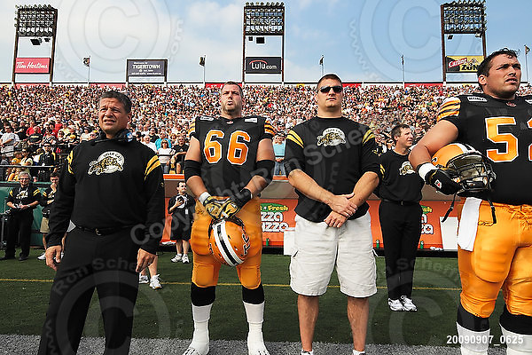 September 7, 2009; Hamilton, ON, CAN; Hamilton Tiger-Cats head coach Marcel Bellefeuille offensive lineman Alexandre Gauthier (66) offensive lineman George Hudson (52). CFL football - the Labour Day Classic - Toronto Argonauts vs. Hamilton Tiger-Cats at Ivor Wynne Stadium. The Tiger-Cats defeated the Argos 34-15. Mandatory Credit: Ron Scheffler.