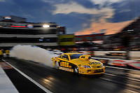 Sept. 17, 2010; Concord, NC, USA; NHRA pro stock driver Jeg Coughlin does a burnout during qualifying for the O'Reilly Auto Parts NHRA Nationals at zMax Dragway. Mandatory Credit: Mark J. Rebilas/