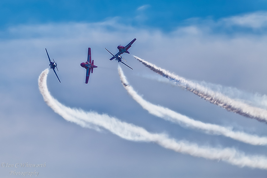 The Snowbirds going in different directions at the Canadian International Air Show.