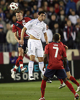 Jay DeMerit(15) of the USA MNT goes up for a header with Oscar Cardoza(7) of Paraguay during an international friendly match at LP Field, in Nashville, TN. on March 29, 2011. Paraguay won 1-0.