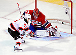 9 January 2010: New Jersey Devils' left wing forward Zach Parise scores the game winning goal in overtime against Montreal Canadiens' goaltender Jaroslav Halak at the Bell Centre in Montreal, Quebec, Canada. The Devils edged out the Canadiens 2-1 in overtime. Mandatory Credit: Ed Wolfstein Photo