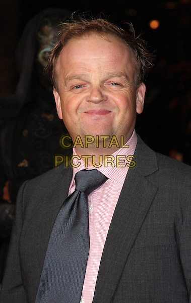 "TOBY JONES .""Harry Potter And The Deathly Hallows: Part 1"" World Film Premiere, Empire cinema Leicester Square and Odeon Leicester Square, London, England, UK, .11th November 2010. .portrait  headshot smiling pink shirt grey gray jacket suit tie .CAP/ROS.©Steve Ross/Capital Pictures."