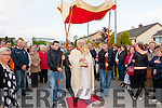 Parade<br /> ----------<br /> Monsenior Dan O'Riordan arrives in Cahereen's West estate,Castleisland last Saturday evening to a large crowd of parishioners.