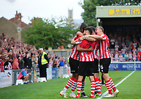 Lincoln City's Matt Green (hidden) celebrates scoring his sides fourth goal with team-mates<br /> <br /> Photographer Chris Vaughan/CameraSport<br /> <br /> The EFL Sky Bet League Two - Lincoln City v Swindon Town - Saturday 11th August 2018 - Sincil Bank - Lincoln<br /> <br /> World Copyright &copy; 2018 CameraSport. All rights reserved. 43 Linden Ave. Countesthorpe. Leicester. England. LE8 5PG - Tel: +44 (0) 116 277 4147 - admin@camerasport.com - www.camerasport.com