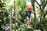 Caio Baraquett, 10, carefully maneuvers each step on the canopy climb at Lagao Adventures, in Parque da Catacumba, in Rio de Janeiro, Brazil, on Saturday, Feb. 2, 2013. The 500 feet long canopy climbing course includes nine obstacles, set 22 feet off the ground.