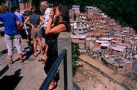 International tourists during sightseeing  in a Rio de Janeiro slum. Brazil.