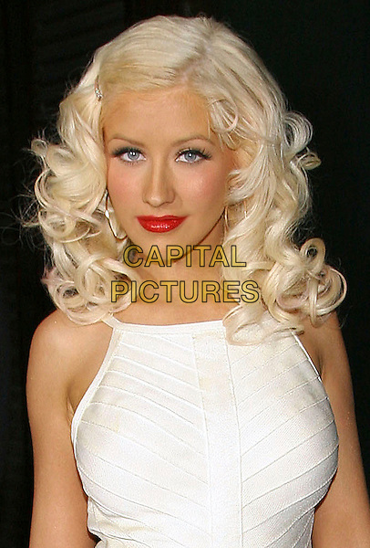 "CHRISTINA AGUILERA.Celebrates the launch of her new album ""Back to Basics"",.New York City, New York, USA,.15 August 2006..half length hoop earrings red lipstick cream white dress eyes to camera hair slide grip clip diamante eye contact eyes to camera.Ref: ADM/JL.www.capitalpictures.com.sales@capitalpictures.com.©Jackson Lee/AdMedia/Capital Pictures."
