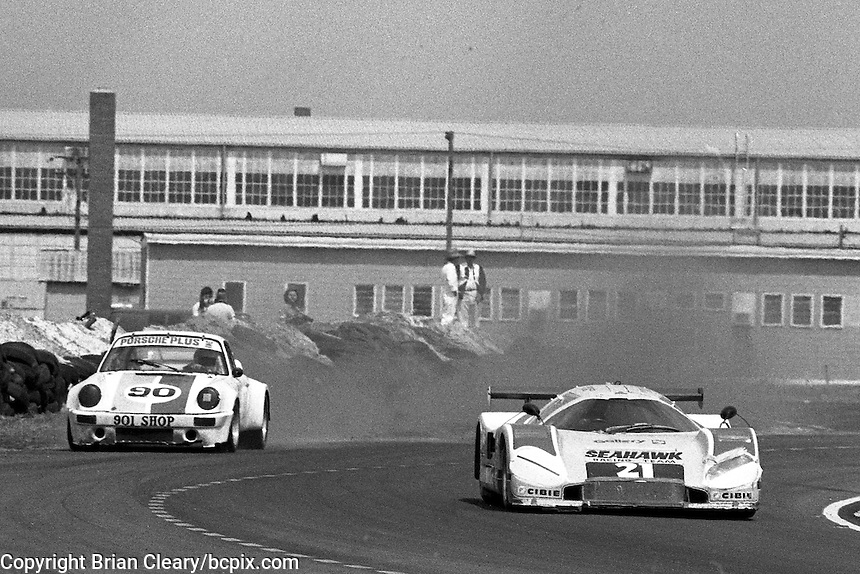 #21 Nimrod NRA Aston Martin of Victor Gonzalez, Drake Olsen, and Bonky Fernandez (61st place) and #90 Porsche 911 of  Mike Schaefer, Doug Zitza, and Jack Refenning (22nd place), 12 Hours or Sebring, Sebring International Raceway, Sebring, FL, March 19, 1983.  (Photo by Brian Cleary/bcpix.com)