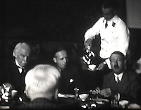 BNPS.co.uk (01202 558833)<br /> Pic: Mullocks/BNPS<br /> <br /> Lloyd George enjoys dinner with Hitler at his home in the Bavarian alps.<br /> <br /> A remarkable film of David Lloyd George's visit to Germany to meet Adolf Hitler in 1936 after which he described him as 'the greatest living German' has emerged for auction.<br /> <br /> The unique black and white 16mm film which lasts 20 minutes shows former Prime Minister Lloyd George and his entourage twice meeting Hitler and driving along newly created autobahns.<br /> <br /> The grainy footage captures Lloyd George with Hitler at a dinner party, him laying a wreath at a war memorial in Munich and the alarming sight of the Nazi and United Kingdom flags hanging together on a German building.<br /> <br /> The film belongs to a British historian with a large collection of archive footage and is tipped to sell for &pound;1,200.