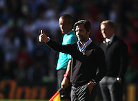 Quique Flores manager of Watford looks pleased   during the Barclays Premier League match Watford and Swansea   played at Vicarage Road Stadium , Watford